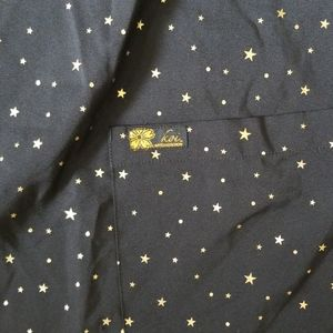 Women's scrub top black worh gold stars